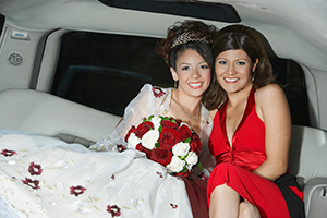 Girl at her quinceanera with her mom in a limo