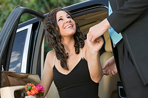 Girl in prom dress exiting limo